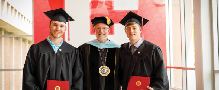 President Mark Putnam posing with Central College's first Engineering graduates.